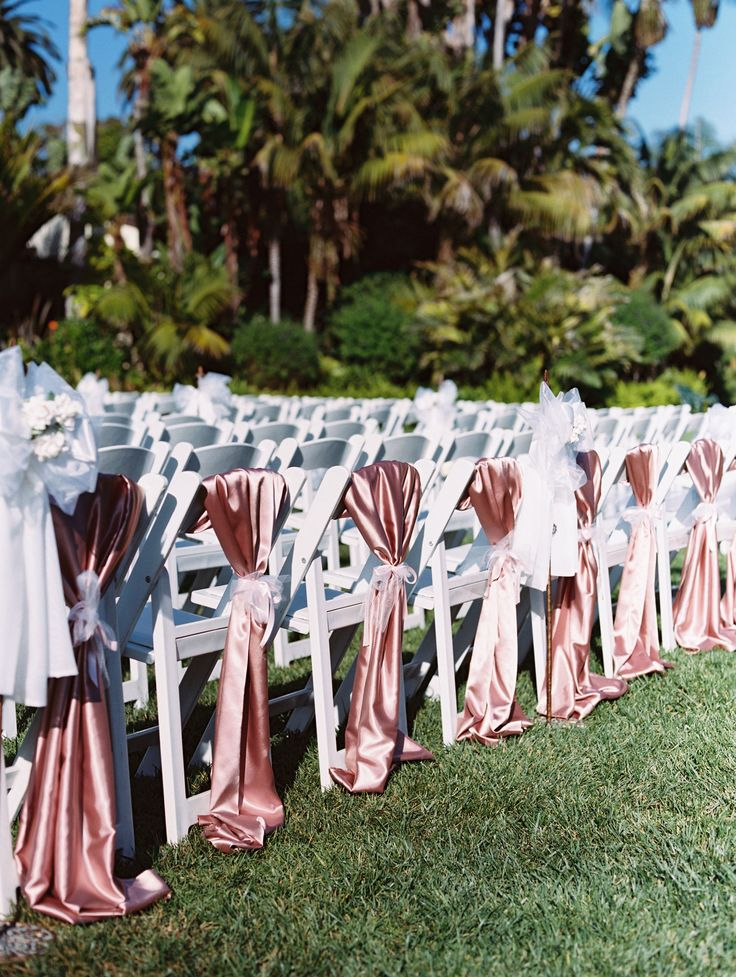 Pink Linens on White Chairs  Photography: Patrick Moyer Read More: http://www.insideweddings.com/weddings/vintage-inspired-alfresco-ceremony-fairy-tale-ballroom-reception/1030/