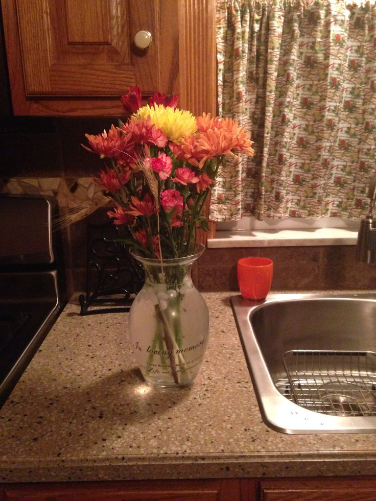 """Vase says """"In loving memory, These flowers bloom as a symbol of a Life and Love remembered"""" from oriential trading"""