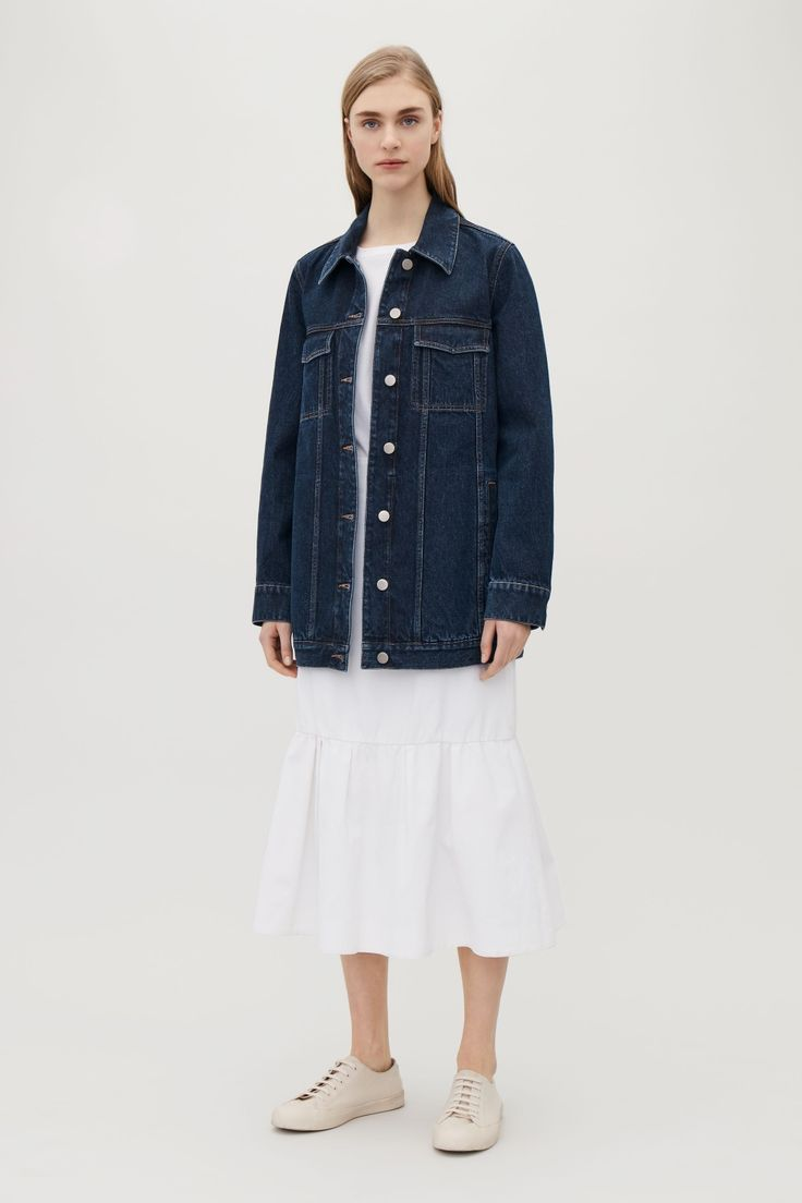 This jacket is made from heavyweight denim with contrast stitching for a raw denim look. An A-line fit, it has metal buttons at the front and a mix of functional pockets.