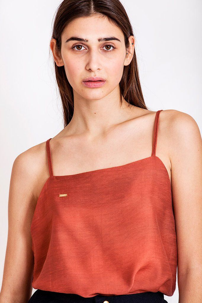 Copper top by Dott. An everyday essential with a twist of glam is exactly what we need. This copper colored top looks stunning tugged into a pair of light jeans or in combination with Dott. long pants, skirt or shorts. The great thing about this top, is that it gives so much breathing room under the arms (and looks really sexy) and this combined with the thin straps and flowy fabric gives us a perfect summer top for the especially warm days.   €60.00 REPIN TO YOUR OWN INSPIRATION BOARD