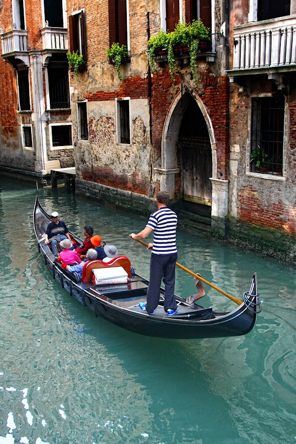 A gondola, steered by a single oarsman, follows age old rituals when the oar is submerged and he walks along the boat that pushes you over the water.  This is the magic od Venice.