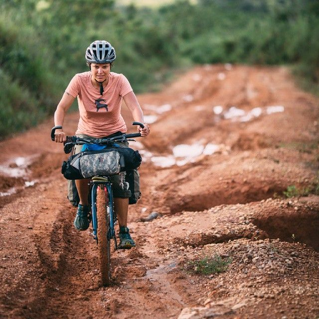 Gin working a muddy climb in Nyika, Malawi. #bikepacking #biketouring