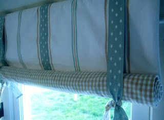 Tie up curtains in the orange and aqua color scheme.