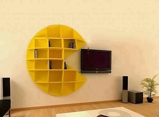 Creative shelving perfect for storing movies, music, and (of course) your vintage Pac-Man collection #home #organization #storage #tv