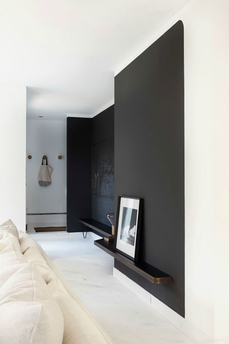 Black wall living room - Industrial Style Living Room With Black Wall And Built In Shelves At A Low Level