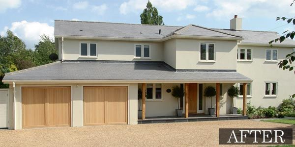 Coloured render, slate roof tiles and timber window frames give the house a contemporary look