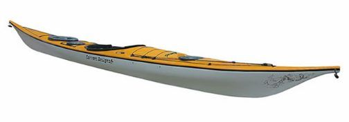 """My boat ! The Andromeda, designed by Derek Hutchinson it has a streamlined profile, echoing the hunting boats of the Angmagssalik region of Greenland. At 17'3"""" long and only 20.5"""" wide, she's fast and fun."""