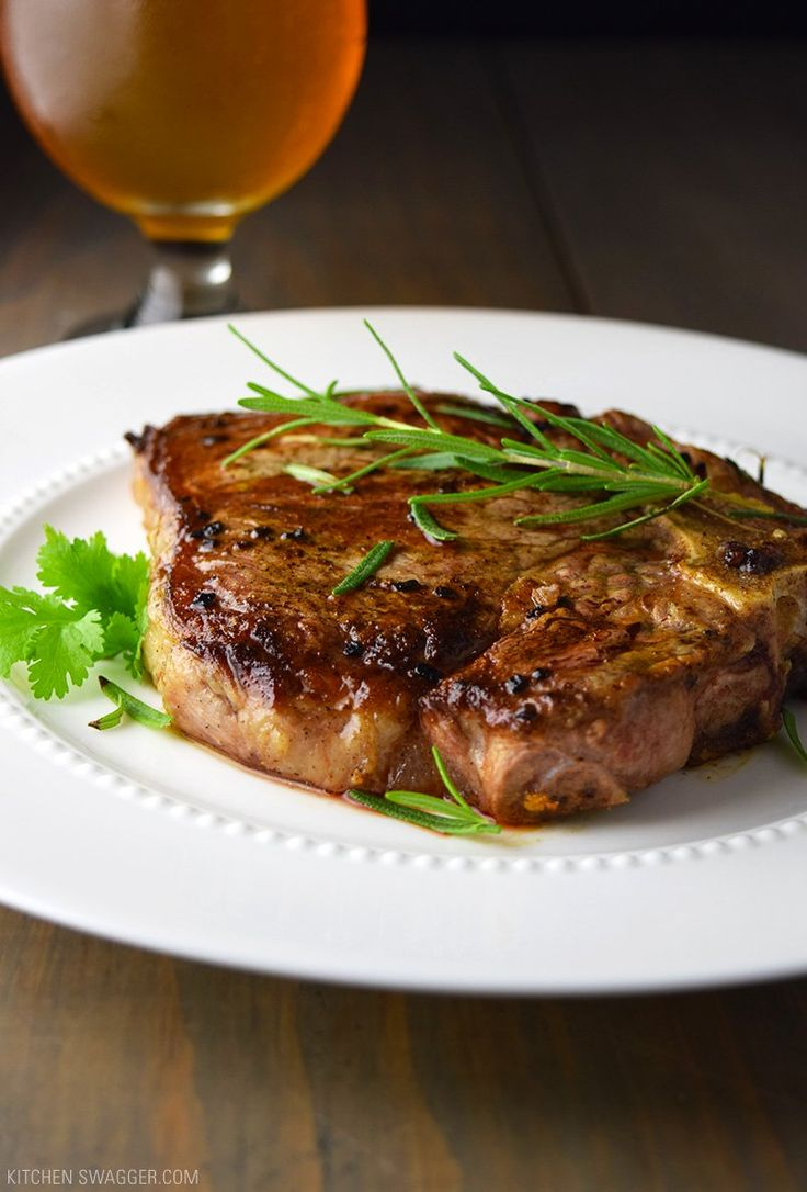 The only way to cook steak. Pan-seared T-bone steak cooked in a cast iron skillet with garlic, butter, and fresh rosemary.