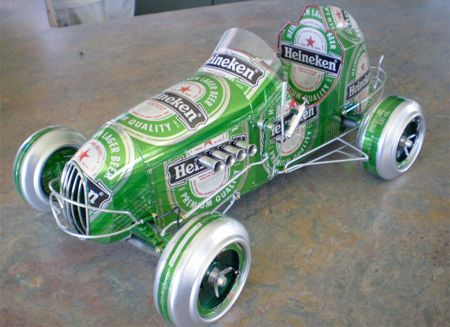 Sandy Sanderson, an artist from New Zealand creates these miniature cars out of recycled soda and beer cans. Bottoms of cans are used to make wheels and the graphics are turned into side panels and decorations for the body.