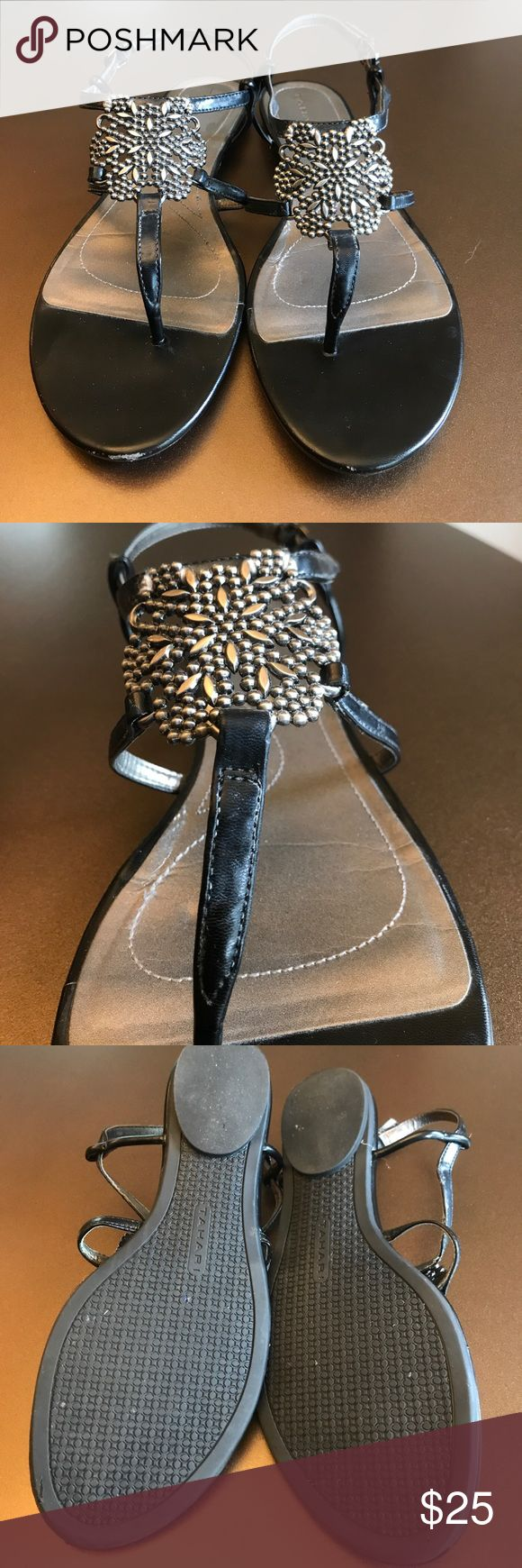 Tahari black flat sandal, adjustable heel strap Tahari black flat sandal with adjustable heel strap. Heel measure 1/4 inch. Cute silver metal design in top. Barely worn, excellent condition, smoke free home. Tahari Shoes Sandals