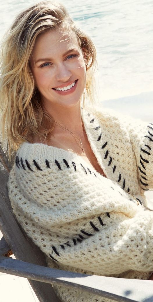 Who made January Jones' tan sweater?