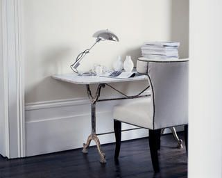 A study decorated in sophisticated shades of white and off-white.