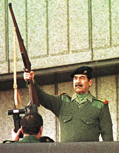 Iraq's then-President Saddam Hussein fires a rifle in Baghdad on Nov. 20, 2000. Saddam fired two rifle shots to kick off festivities celebrating Iraq's commitment to liberating the holy city from Israeli rule. When U.S. leaders decided it was time to depose Saddam Hussein, he made the perfect foil. He was cocky and cunning. He looked dangerous and deranged standing at rallies firing a rifle into the air - conduct unbecoming a head of government.