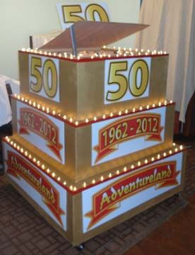 50 anniversary real cake and lights pop out cake largest cake #17 . Call for purchase or rental with less than One hour notice. 866-396-8429