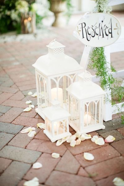 Lantern wedding decor idea - vintage, lantern ceremony aisle markers with candles and flower petals - perfect for  a spring wedding {John Arcara Photography}