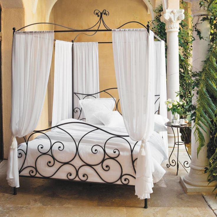 cama con dosel de metal marrn