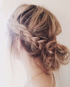 dutch braid into a low messy bun