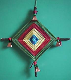 """Growing up in New Mexico, we always made these """"Ojos de Dios"""" (Eyes of God) every Christmas as ornaments.  You can make them any time as a wall accent or mobile."""