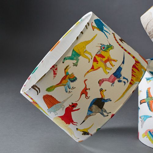 Dinosaur lampshade, featuring colourful dinosaurs with colours inspired by living reptiles. Perfect for a nursery or kid's room.