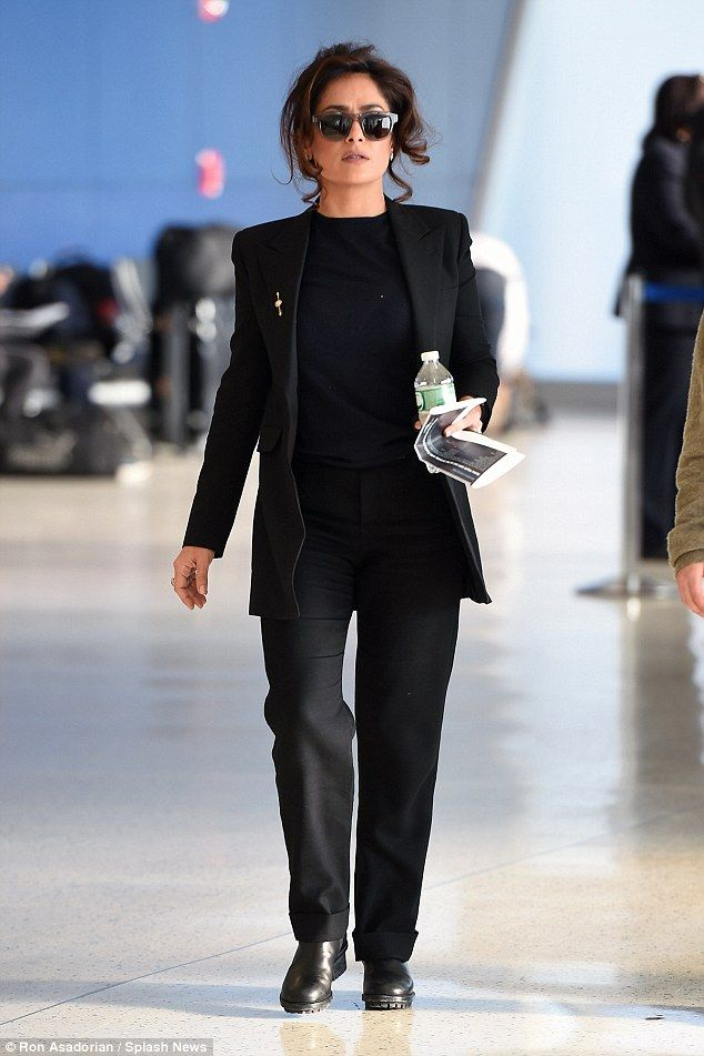 Suits you! Salma Hayek looked incredible smart as she walked through JFK airport on Saturd...