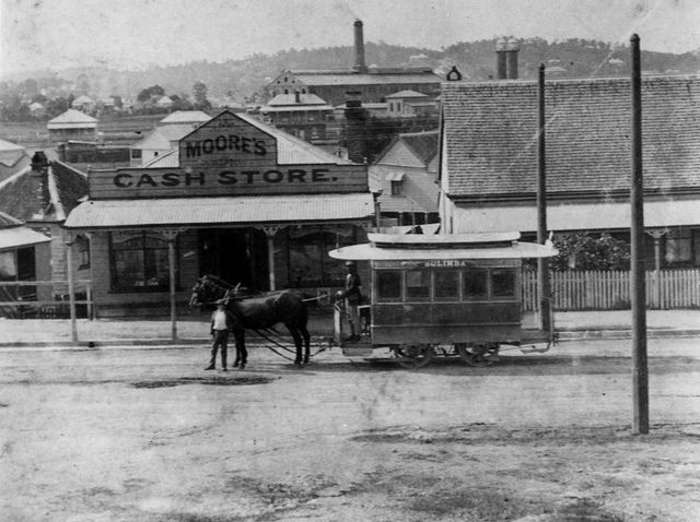 Moore's Cash Store in Commercial Road, Fortitude Valley, Brisbane, ca. 1894. A Bulimba horsedrawn tram appears in the foreground.