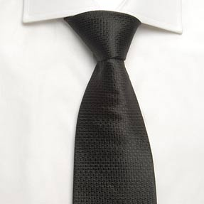 Plain Black Natte Tie    This luxurious black natte 100% silk textured tie is an opulent addition to any smart attire. Choose this Hawes and Curtis tie for a stylish, professional finish to your outfit or as the perfect gift. Made from 100% silk in a standard length. This tie is only suitable for dry cleaning.