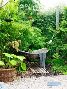 Hammock surrounded by rustling bamboo - Terrace with canopy of trees - Hus & Hem