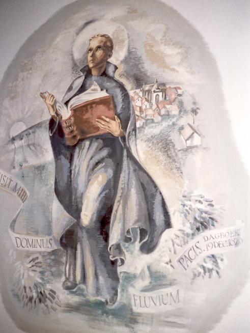Jan Berchmans - ca 1953. Wandschildering door Guus van Hemert Nederland, Nijmegen, Berchmanianum, eetzaal. Jan Berchmans met studieboek (Thomas van Aquino); op de achtergrond zijn geboorteplaats Diest. Tekst op de banderol: 'De Heer zond mij een stroom van vrede'.