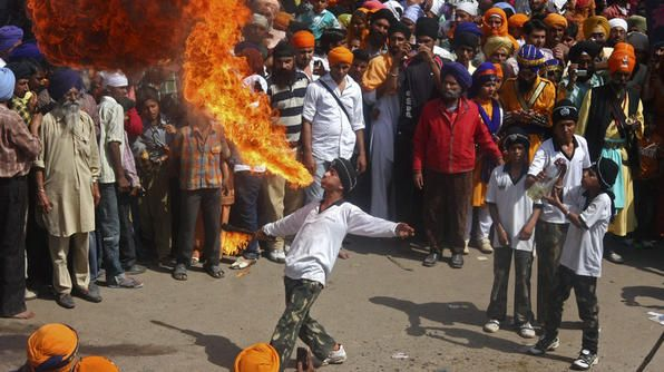 Holla Mohalla - During this 3 day Sikh festival, celebrants showcase their martial skills in mock fights and the art of fire breathing, like here on a street in the northwest Indian state of Punjab. The spring festival is also a time when followers reaffirm their dedication to Khalsa Panth (the worldwide commmunity of Sikhs).