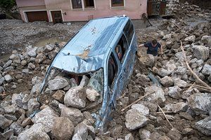 Deaths as flash floods hit France, Germany and Austria Bodies found of people trapped in houses, villages flooded and roads wrecked, with forecasters warning of more downpours and rising waters in coming days...A smashed car among debris in Braunsbach, southern Germany.