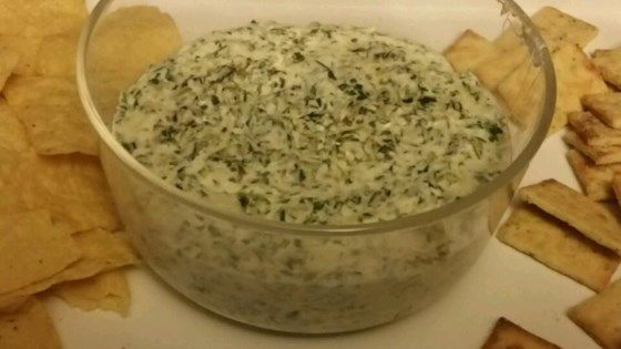 This cheesy and creamy hot dip is perfect for entertaining and can also be served as an appetizer. Serve with pita bread, baguette, tortilla chips, or veggies.