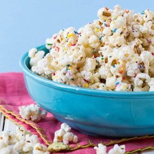 This Cake Batter Popcorn recipe only has a few ingredients and will turn boring popcorn into fun and festive popcorn in a matter of minutes!