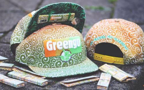 "Lauren Rose Snapback Cap Greengo  The ultimate cap for all Greego lovers!   The Greengo cap has an embroided Greengo logo on the front and at the side of the the cap. On the back of the cap you will find the slogan ""Go Green, go Greengo"". The inside of the visor is embellished with a print of hemp leaves.  This cap is unique because you can hide your favorite Greengo papers under the visor. The cap also has a hidden pocket where you can hide little things.   Buy this unique Greengo Snapback…"
