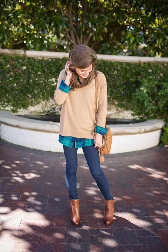 Layer a Gap V-neck sweater over your favorite flannel for a comfortable and cool winter outfit. Blogger Brighton the Day styles this look with skinny jeans and booties.