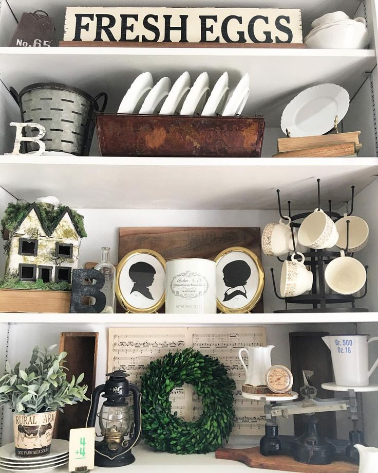 Farmhouse-style decor | The Rustic Boxwood | rustic, vignette, home decor, interior decorating, style, interior design, farmhouse decorating, plate rack, silhouette, boxwood, greenery, old scales, decorating ideas