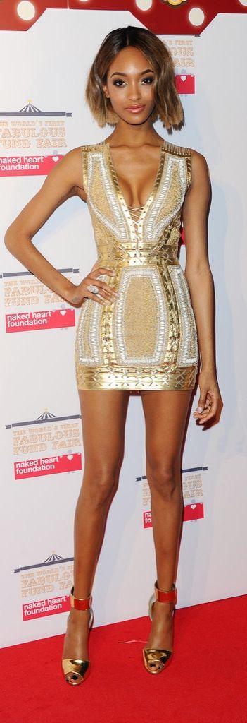Jourdan Dunn in a gold minidress