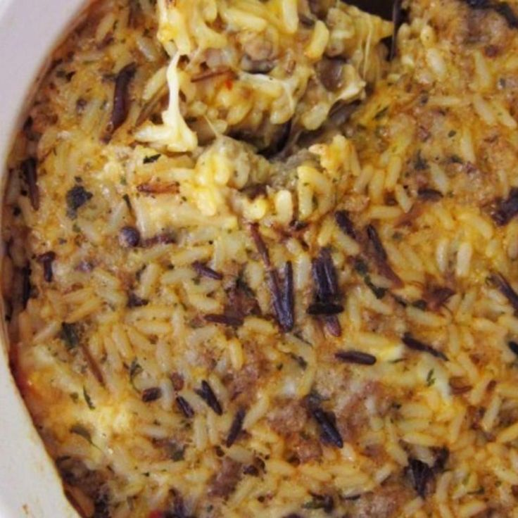 My Mom made this when we were growing and it is still a family fav. This is what I make when I want some comfort food. There are several versions of the recipe on here but ours is a little different; addition of pimientos adds a pop of color and sharp cheddar cheese... need I say more? Use your favorite bulk sausage. I like to use the hot; really kicks it up a notch!