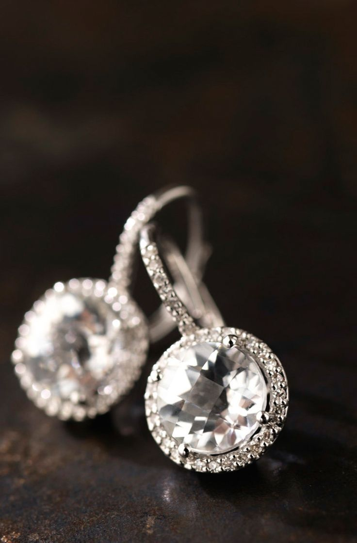 Antique diamond earrings...love the design.