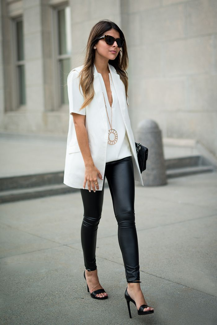 fall / winter - street chic style - street style - black and white - summer outfits - fall outfits - party outfits - office wear - work outfits - white v-neck top + white vest + leather leggings + black ankle strap heeled sandalsl + black sunglasses