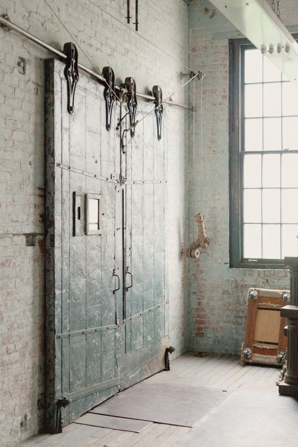 Vintage door dreams: Modern Industrial living spaces via blood and champagne blog.