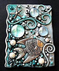 fish relief -on canvas boards with glue, found objects, metallic and cool color paints rubbed over dry piece.