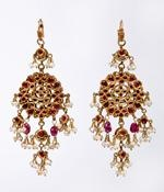 - A pair of gold earrings