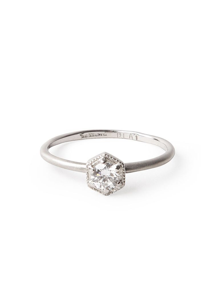 Something small and understated, because an engagement ring is a symbol of commitment, not of net worth.