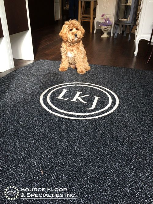 We created this custom-shaped logo entrance mat for Laura K Jewitt, a local Vancouver custom jeweler.  This mat features our Grizzly FX in Onyx colour, with an inlaid logo in Ivory.