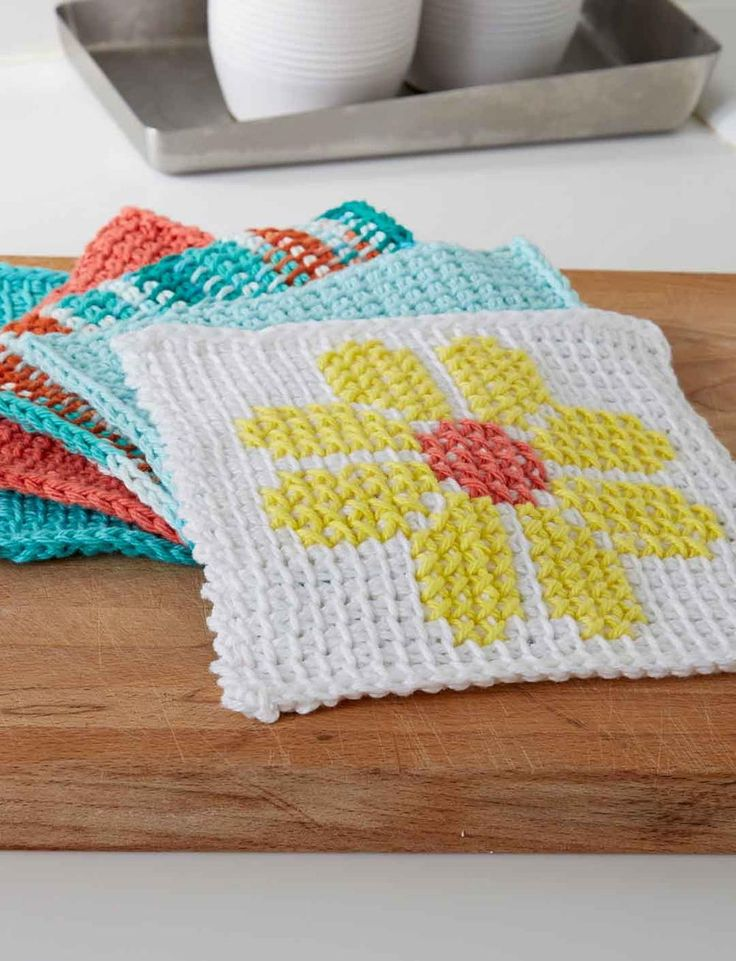 Tunisian Crochet Flower Dishcloth. Would make a cute baby blanket. Make some up and sew together