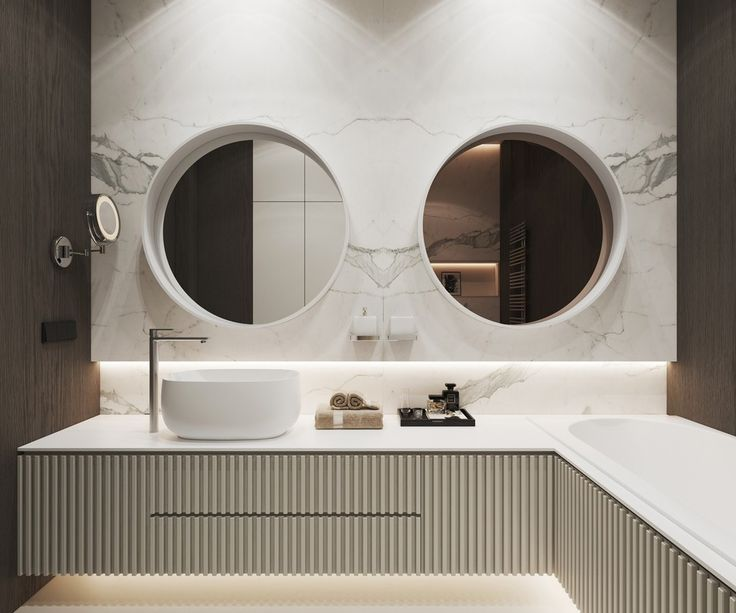 modern bathroom with circular double mirror #archovo #architectonline #architettoonline www.archovo.com