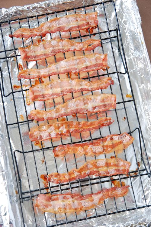 Crispy bacon from the oven:  1. Preheat the oven to 400 degrees.  2. Line a baking sheet with foil (for easy cleanup!)  3. Place a cooling rack inside the pan (this way the bacon won't sit in the grease — making it crispier).  4. Spray the cooling rack with nonstick spray and lay the bacon along the rack.  5. Bake for 15-20 minutes, or until crispy!    And viola, crispy hands-off bacon!