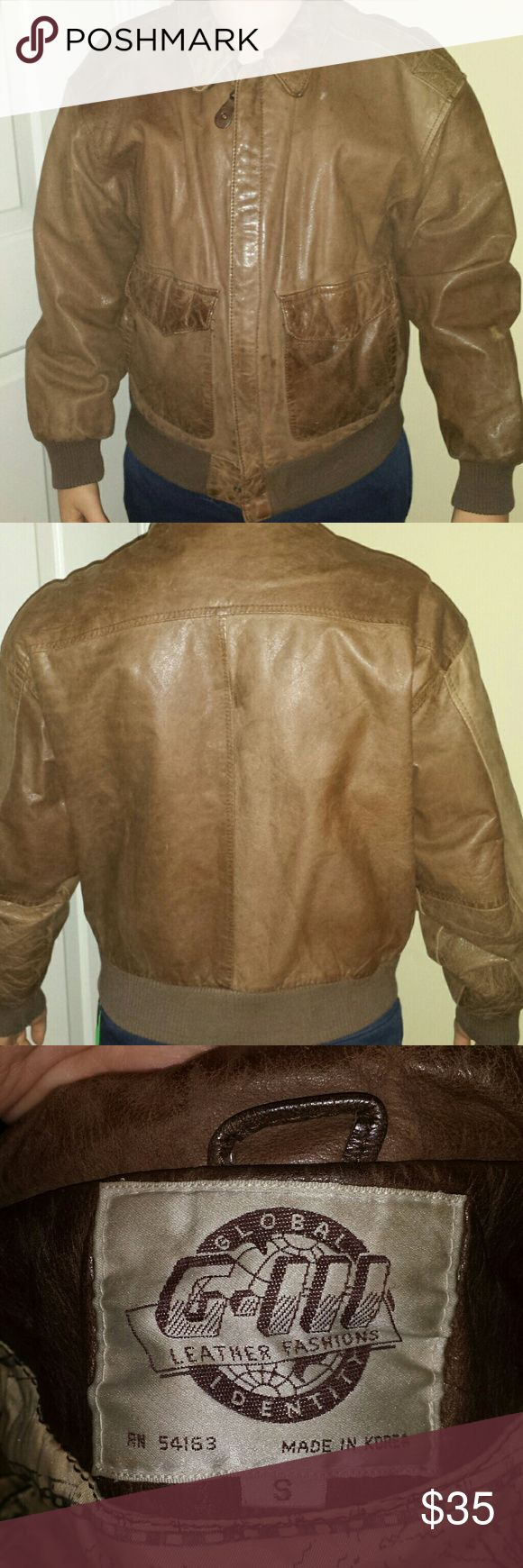 "Vintage 80's Unisex Leather Bomber Jacket Straight from the 80's!  *Excellent vintage condition * Ribbed waistband and wristbands.  * Poly satin printed lining is intact. No rips, tears or stains. Zipper and snaps all work.   * Leather has aged patina, as well as a purposeful distressed look - it was the 80's, they distressed everything back then :)  * Men's small. Would fit a women's medium. The model in the pic is a 5'2"", 115 lb young man.  * Armpit to armpit when measured flat is 22""…"