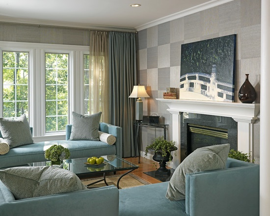 Cream Walls White Trim Tan Couch Blue Chair Fireplace