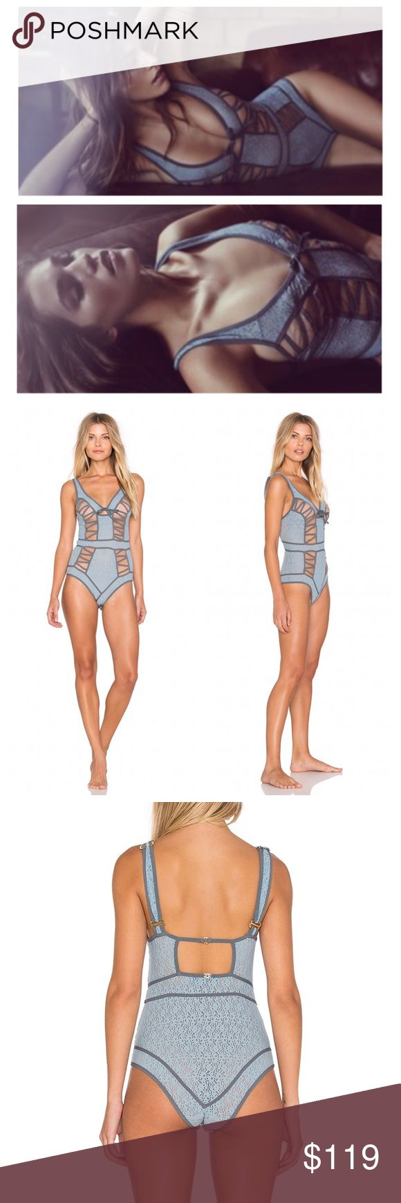 For Love & Lemons Samantha Bodysuit in Blue Illusion mesh panels punctuate the sultry, strappy design of this floral lace bodysuit from For Love & Lemons. Size M(4-6)  Nylon/spandex V-neck with center bow detail Adjustable straps Sheer floral lace body, front illusion mesh panels Solid strap detailing throughout, square back Back cutout with hook closure, bikini fit in rear Lined gusset with hook-and-eye closure For Love and Lemons Intimates & Sleepwear